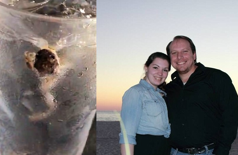Claire Sheats with her husband (R) and frog in water cup