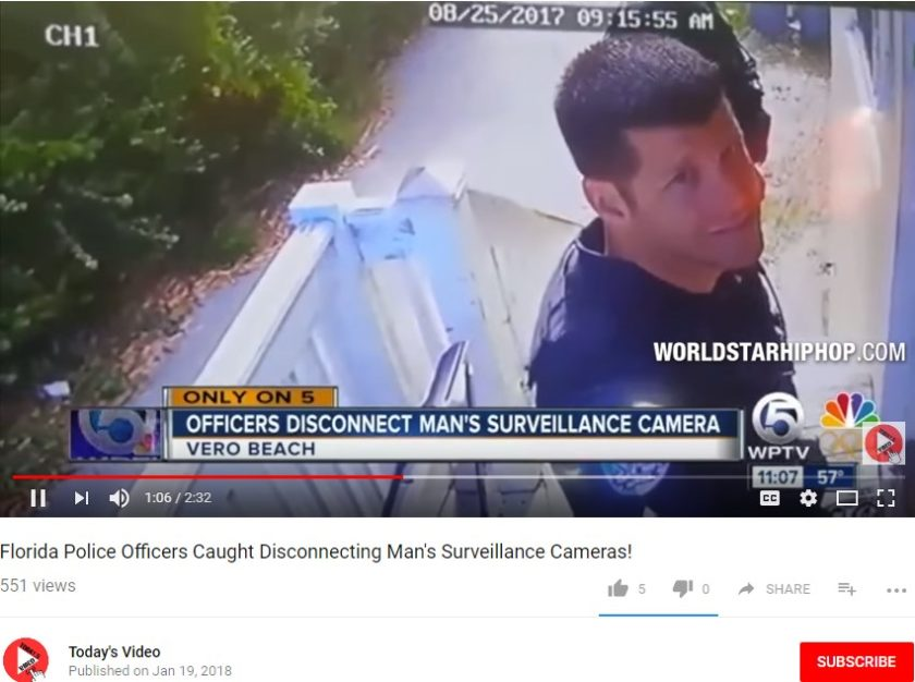 The officer disconnecting the surveillance camera