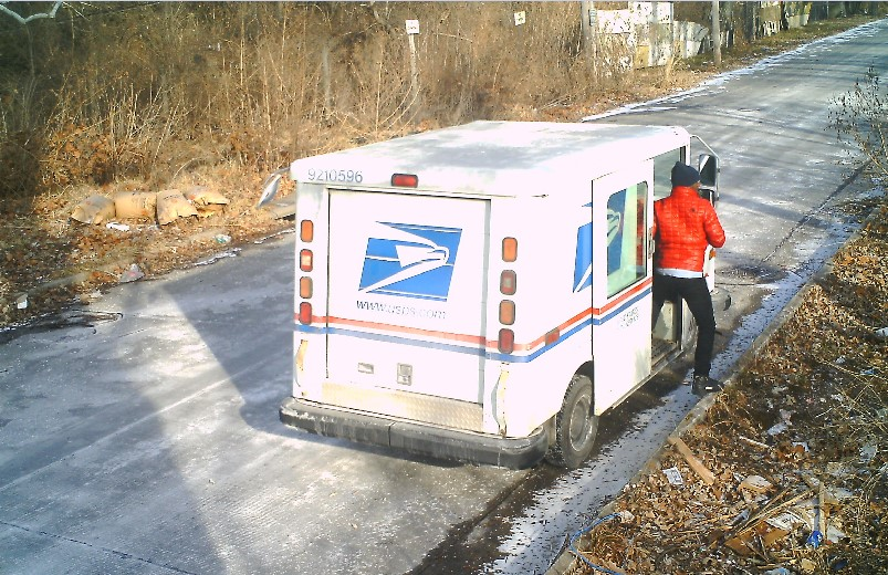 United States Postal Service employee dumping mail