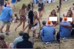 Madeline Anello-Kitzmiller walking topless at the Rhythm & Vines festival