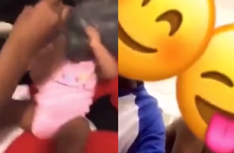 Teenage parents place plastic bag on their child